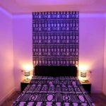 Soveværelse i blå aftenbelysning - Ferielejlighed Monti Hill Colosseo i Rom